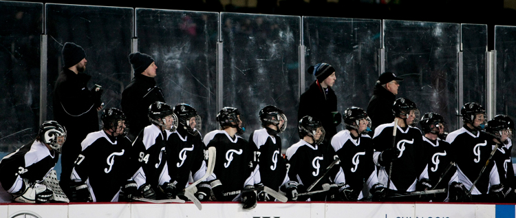 Fenwick players watch from the bench as teammates battle St. Rita in the second period during the Hockey City Classic game at Soldier Field on Saturday, February 9, 2013.  | Michael Jarecki ~ For Sun-Times Media