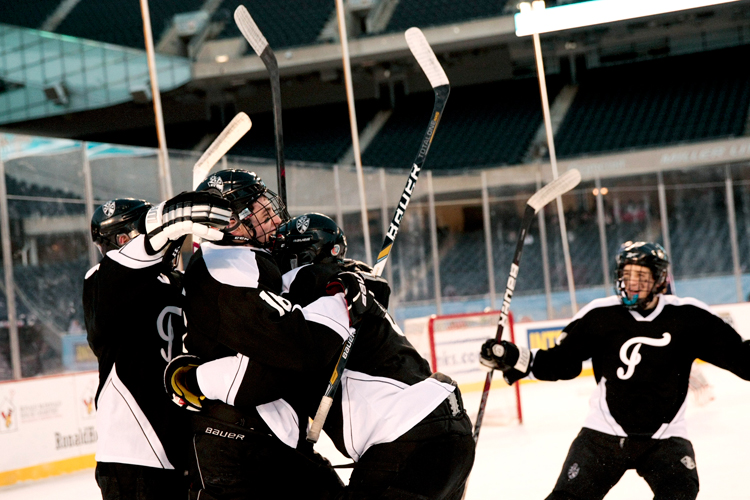 Fenwick's Ben Kohen (16) celebrates with teammates after scoring the first goal of the game in the first period during the Hockey City Classic game against St. Rita at Soldier Field on Saturday, February 9, 2013.  | Michael Jarecki ~ For Sun-Times Media