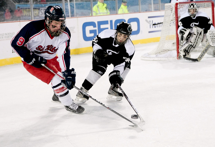 St. Rita senior Christopher Foley (9) battles Fenwick's Mack Sinnott (93) for the puck in the second period during the Hockey City Classic game at Soldier Field on Saturday, February 9, 2013.  | Michael Jarecki ~ For Sun-Times Media