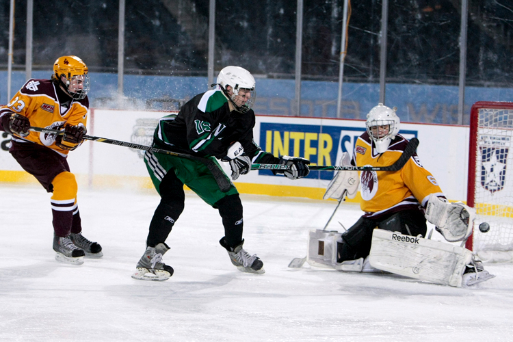New Trier's Zev Glass (16) misses a shot on goal in the third period during the Hockey City Classic game against Loyola at Soldier Field on Saturday, February 9, 2013.  New Trier defeated Loyola 3-1. | Michael Jarecki ~ For Sun-Times Media