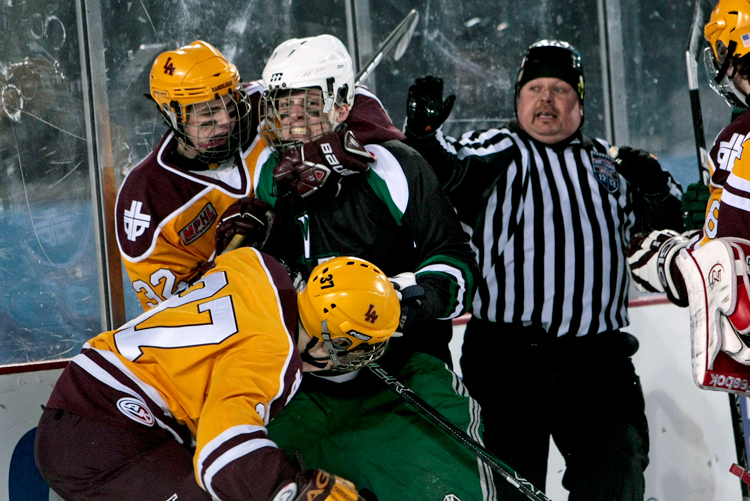 Loyola's John Buck (32) grabs New Trier's Zev Glass (16) after a whistle in the second period during the Hockey City Classic game at Soldier Field on Saturday, February 9, 2013. New Trier defeated Loyola 3-1. | Michael Jarecki ~ For Sun-Times Media