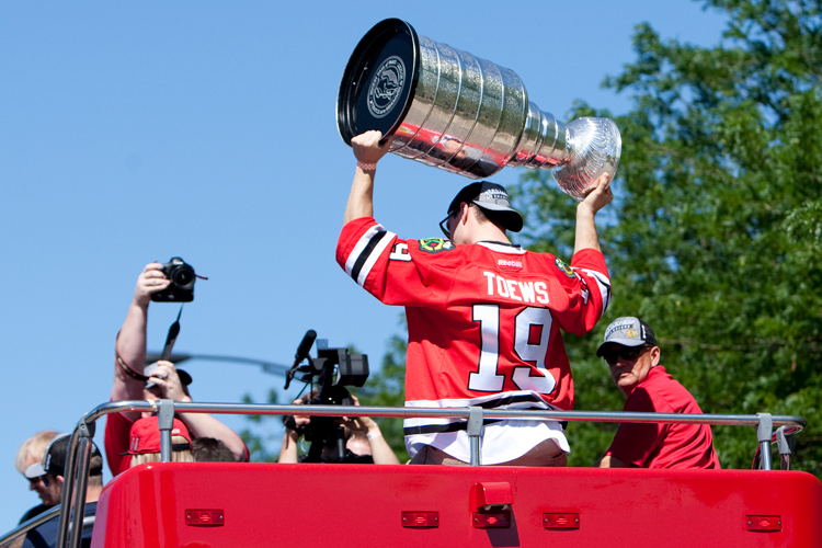 Chicago Blackhawks captain JONATHAN TOEWS (19) raises the Stanley Cup outside of the United Center before the start of the parade through downtown Chicago on Friday, June 28, 2013.  (Credit Image: © Michael Jarecki/ZUMAPRESS.com)
