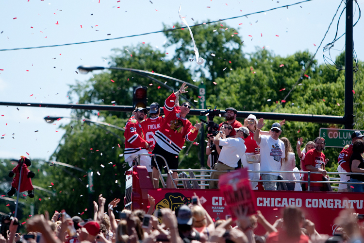 Chicago Blackhawks forward MARIAN HOSSA (81) attempts to catch a roll of toilet paper that was thrown front he crowd during the victory parade through downtown Chicago on Friday, June 28, 2013.  (Credit Image: © Michael Jarecki/ZUMAPRESS.com)