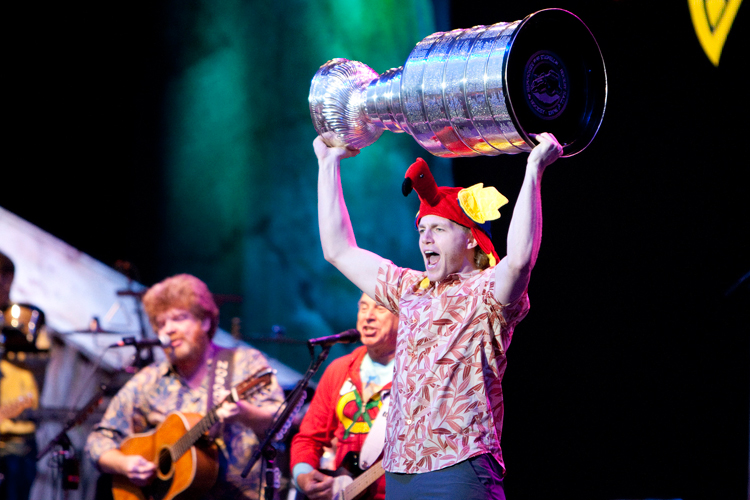 Chicago Blackhawks forward Patrick Kane (88) enters the stage while hoisting the Stanley Cup during Jimmy Buffett performance at the First Merit Bank Pavilion at Northerly Island in Chicago on Saturday, June 29, 2013.  | Michael Jarecki ~ For Sun-Times Media