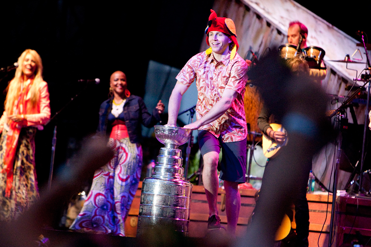 forward Patrick Kane (88) dances around the Stanley Cup during the Jimmy Buffett concert at the First Merit Bank Pavilion at Northerly Island in Chicago on Saturday, June 29, 2013.  | Michael Jarecki ~ For Sun-Times Media