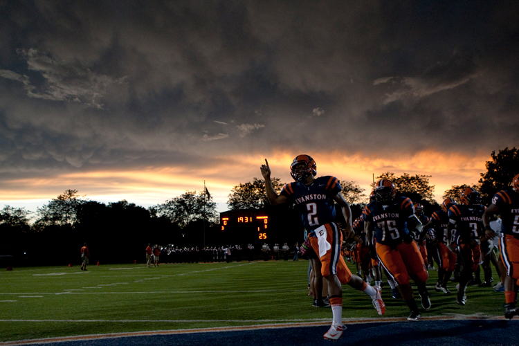 Evanston's quarterback Chris Little (2) leads his team onto the field before the start of the home opener against Proviso West at Evanston Township High School on Friday, August 30, 2013.   | Michael Jarecki/For Sun-Times Media