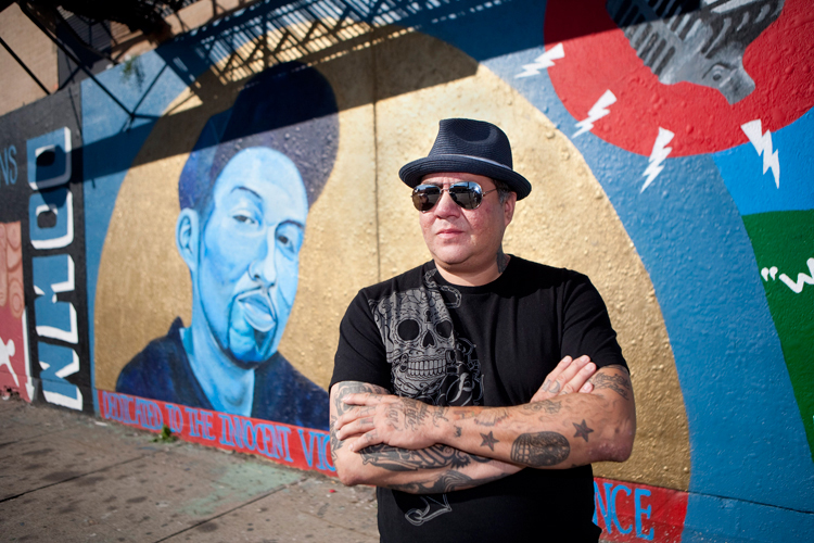 Chicago artist Jeff Abbey Maldonado poses for a portrait in front of the mural he painted of his son Jeff Jr., who was killed in 2009 from gunfire, at the corner of Paulina and 18th street in Chicago on Friday, September 27, 2013.   | Michael Jarecki/For Sun-Times Media