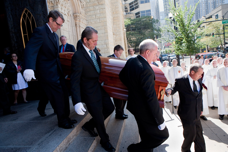 Pallbearers carry the casket of Bishop Timothy J. Lyne out of Holy Name Cathedral during the Funeral Liturgy ceremony on Monday, September 30, 2013.   Bishop Lyne served as a priest in Chicago for 70 years, he died at the age of 94.  | Michael Jarecki/For Sun-Times Media
