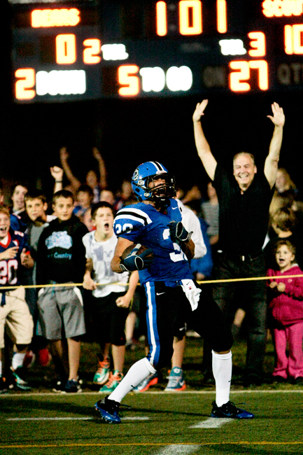 Lake Zurich sophomore Ben Klett (30) reacts after scoring a touchdown on a pass late in the second quarter of the home game against Lake Forest on Friday, September 27, 2013.  | Michael Jarecki/For Sun-Times Media