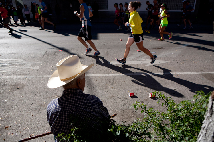 Higinio Lechuga of Chicago, watches as runners pass by near the intersection of Allport and 18th Street in the Pilsen neighborhood during the 36th annual Chicago Marathon on Sunday, October 13, 2013.  | Michael Jarecki/For Sun-Times Media