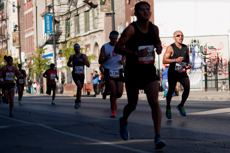 Runners head east on 18th Street in the Pilsen neighborhood while participating in the 36th annual Chicago Marathon on Sunday, October 13, 2013.  | Michael Jarecki/For Sun-Times Media
