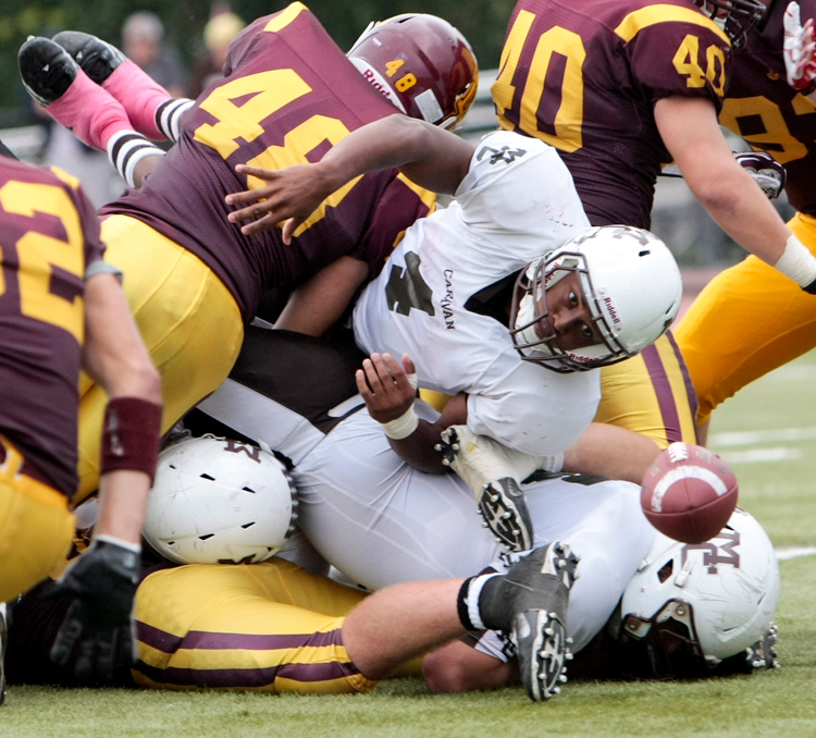 Mount Carmel senior Matt Domer (4) watches the ball hit the ground after fumbling in the third quarter during the game at Loyola on Saturday, October 5, 2013. | Michael Jarecki/For Sun-Times Media