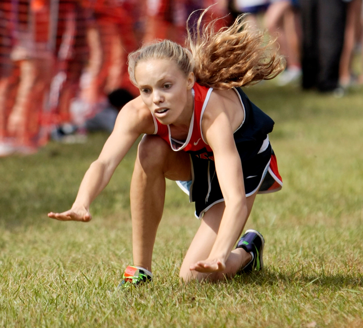 Oak Park River Forest's Hallie Voss falls near the finish line during the 45th Annual Roy Gummerson Cross Country Invitational meet at Schiller Woods in Chicago Saturday, September 28, 2013.  Voss did get up to finish the race.      Michael Jarecki/For Sun-Times Media