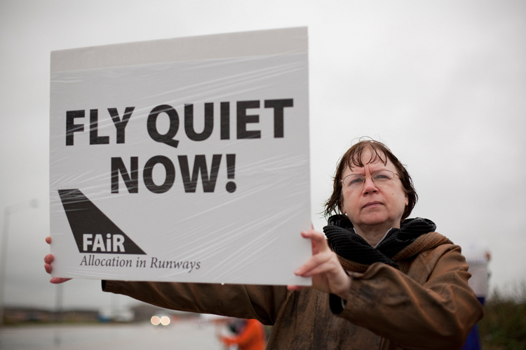 Nora Shea of Chicago, protests the opening of a new runway at Chicago's O'Hare International airport with other members of the FAiR Coalition at the intersection of Irving Park Road and Taft Avenue near the airport on Thursday, October 17, 2013.   | Michael Jarecki/For Sun-Times Media