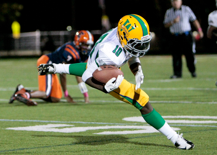 Waukegan junior Jeremy Johnson (10) catches a pass during the game at Evanston Township High School on Friday, October 11, 2013.  | Michael Jarecki/For Sun-Times Media