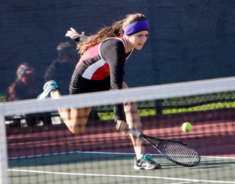Maine South freshman Kamila Czosnyka saves a low hit ball while competing in the doubles match with partner Marti Wind (not pictured) against Glenbrook North freshman Colette O' Reagan and Hailey Kortez (both not pictured) during the IHSA Girls Sectional Tennis meet at Glenbrook North High School on Saturday, October 19, 2013.   | Michael Jarecki/For Sun-Times Media