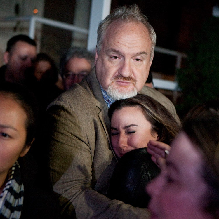 Chef Art Smith, owner of Table 52 restaurant, hugs Jennifer Trotter, sister-in-law of Charlie Trotter, during a candle light vigil for Trotter outside of his now closed restaurant in Chicago on Tuesday, November 5, 2013.  Trotter died at the age of 54.   | Michael Jarecki/For Sun-Times Media