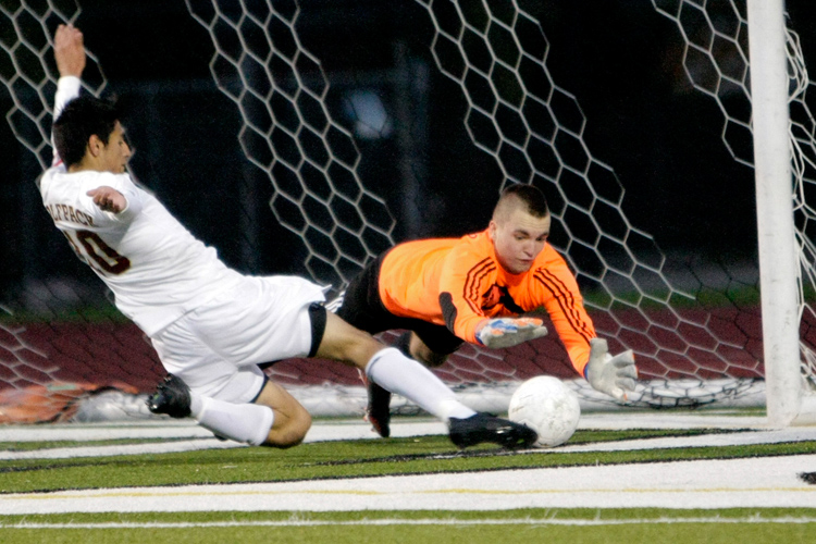 Ridgewood goaltender Wojtek Gasienica (1) makes a save on Saint Ignatius senior Marco Sanchez (10) in the first half during the Class 2A sectional final at Ridgewood High School on Friday, November 1, 2013.   Saint Ignatius defeated Ridgewood 2-1.   | Michael Jarecki/For Sun-Times Media