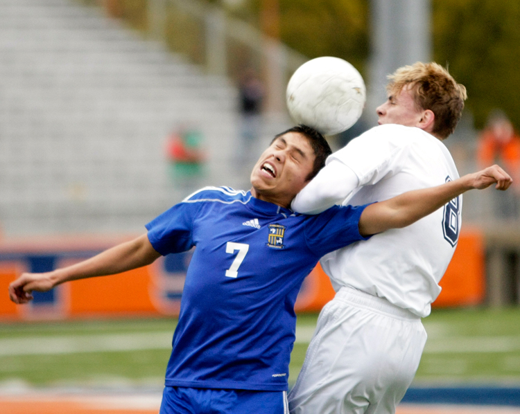 Wheeling sophomore Juan Hernandez (7) battles Evanston junior Kepler Worobec (8) for the ball during the Class 3A sectional final at Evanston Township High School on Saturday, November 2, 2013.  Wheeling defeated Evanston 2-1.  | Michael Jarecki/For Sun-Times Media