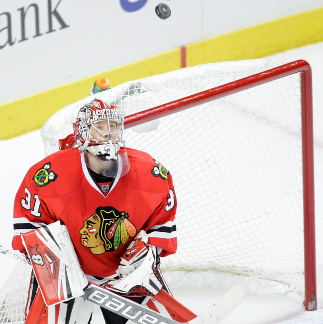 Chicago Blackhawks goaltender Antti Raanta (31) looks at the puck before gloving it out of the air in the second period during the home game against the LA Kings on Sunday, December 15, 2013.  | Michael Jarecki/For Sun-Times Media