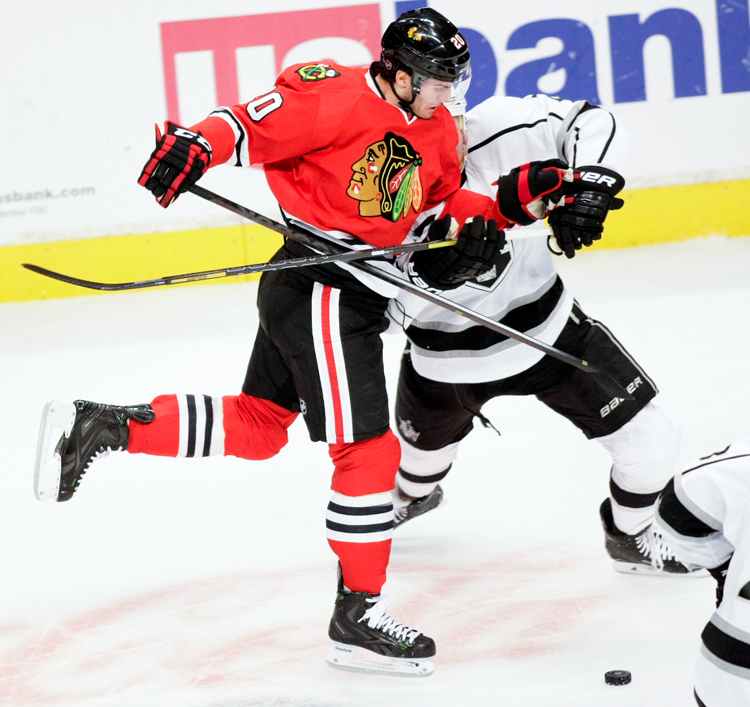 Chicago Blackhawks forward Brandon Saad (20) tries to get around LA Kings defenseman Matt Greene (2) in the second period during the home game on Sunday, December 15, 2013.  | Michael Jarecki/For Sun-Times Media