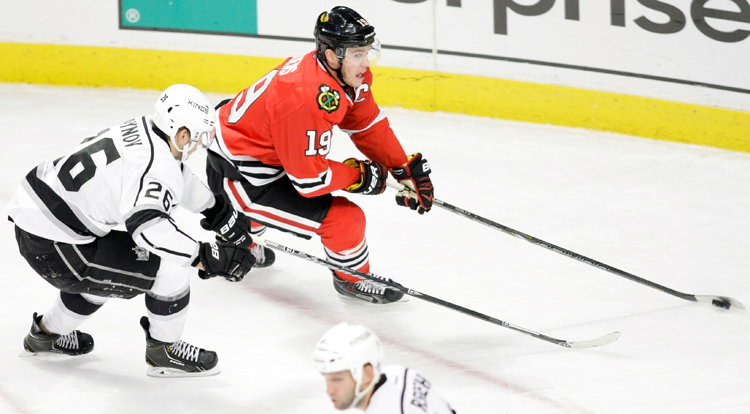 Chicago Blackhawks captain Jonathan Toews (19) looks to pass the puck in the offensive zone during the second period during in the game against the LA Kings on Sunday, December 15, 2013.  | Michael Jarecki/For Sun-Times Media