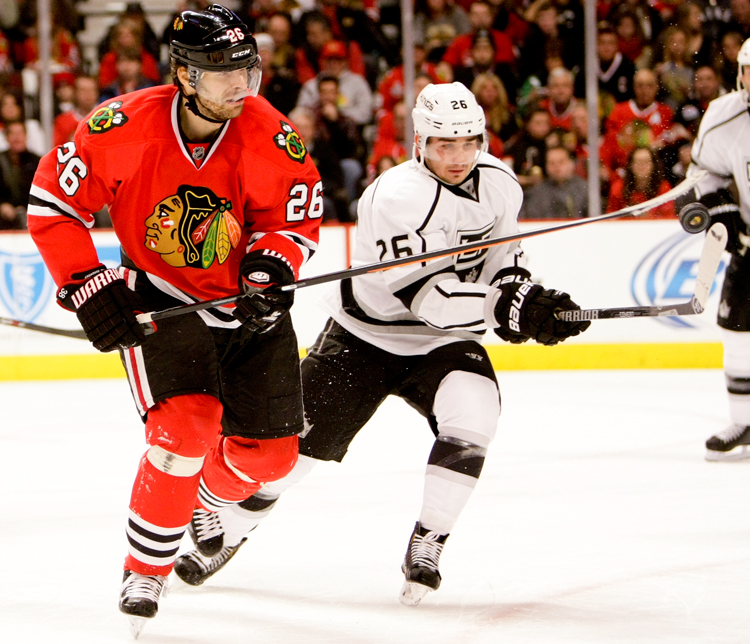 Chicago Blackhawks center Michal Handzus (26, left) battles LA Kings defenseman Slava Voynov (26) for the puck in mid air during the third period on Sunday, December 15, 2013.  The Blackhawks defeated the LA Kings 3-1.   | Michael Jarecki/For Sun-Times Media