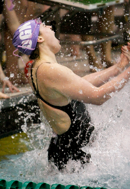 Downers Grove North senior Gabby Simms reacts after finishing in first place in the 400 Yard Freestyle Relay event during the IHSA State Swimming Finals at New Trier High School on Saturday, November 23, 2013.  | Michael Jarecki/For Sun-Times Media