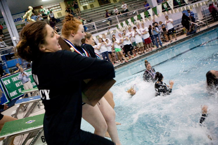 New Trier seniors Kara Lucenti (left) and Juliette Corboy celebrate by jumping into the pool with the first place IHSA State Swimming Finals trophy at New Trier High School on Saturday, November 23, 2013.  | Michael Jarecki/For Sun-Times Media