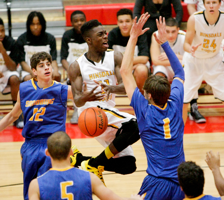Hinsdale South senior Marcel Phillips (11) looses the ball after being fouled driving to the net during the Hinsdale Central 1st Annual Red Devil Thanksgiving Tournament game against Carl Sandburg on Friday, November 29, 2013.  Hinsdale South defeated Sandburg 56-40. | Michael Jarecki/For Sun-Times Media