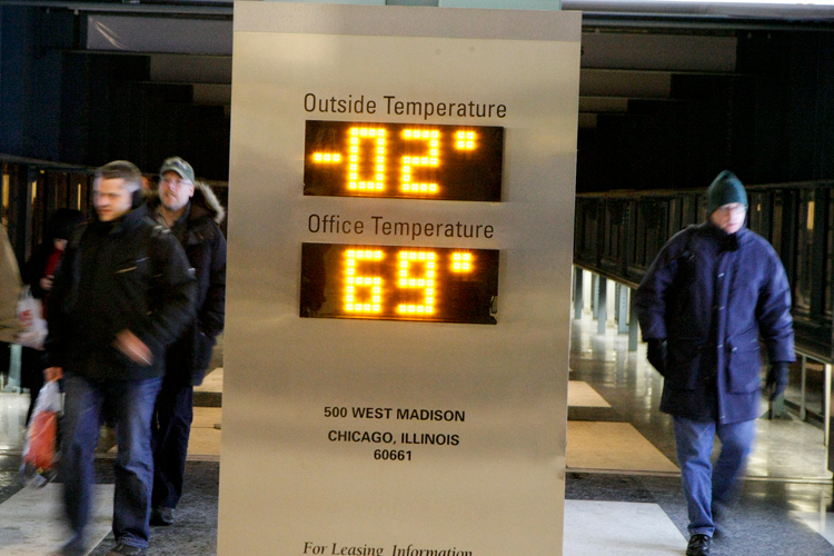 Metra riders walk past a temperature gauge while entering the Ogilvie Transportation Center in downtown Chicago on Monday, January, 6, 2014.  Many train routes were delayed or canceled due to the weather conditions.  | Michael Jarecki/For Sun-Times Media