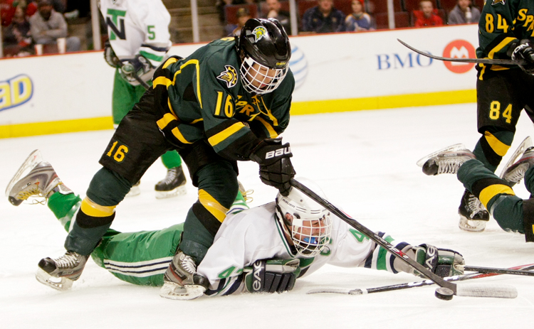 Glenbrook North junior Christopher Zhang (16) tries to control the puck around a divining New Trier junior Matt Boscow (47) in the first period of the Illinois State Championship game at the United Center in Chicago on Thursday, March 20, 2014.  New Trier defeated Glenbrook North 2-1. | Michael Jarecki/For Sun-Times Media