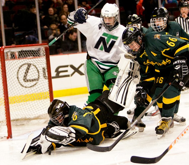 Glebrook North goaltender Nathan Berger (20) dives to cover the puck in the second period during the Illinois State Championship game against New Trier at the United Center in Chicago on Thursday, March 20, 2014.  New Trier defeated Glenbrook North 2-1.    | Michael Jarecki/For Sun-Times Media