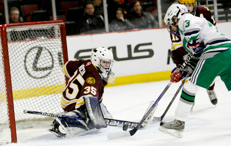 Loyola goaltender Mia Rascia (35) makes a save on New Trier senior Elizabeth Hoff (73) during the Illinois State Championship game at the United Center in Chicago on Thursday, March 20, 2014.  New Trier defeated Loyola 3-2 in double overtime.    | Michael Jarecki/For Sun-Times Media