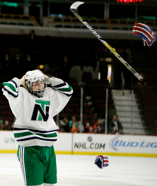 New Trier junior Ivy Dynek (77) throws her gear after he team defeated Loyola 3-2 in double overtime in the Illinois State Championship game at the United Center in Chicago on Thursday, March 20, 2014.    | Michael Jarecki/For Sun-Times Media