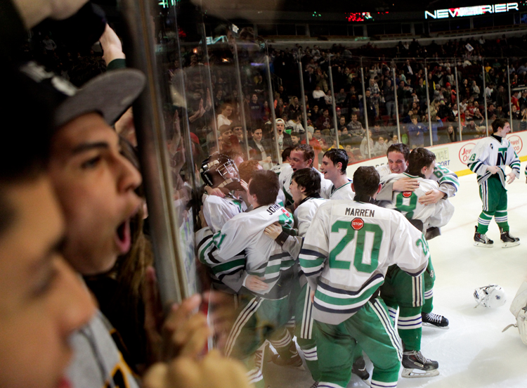 New Trier players celebrate after defeating Glenbrook North 2-1 in the Illinois State Championship game at the United Center in Chicago on Thursday, March 20, 2014.   | Michael Jarecki/For Sun-Times Media