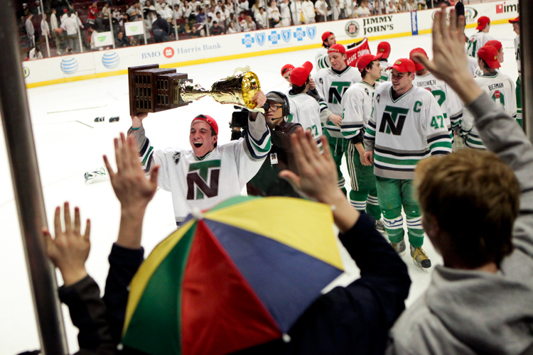New Trier junior Matt Garcia (65) celebrates with the Illinois State Championship trophy after his team defeated Glenbrook North 2-1 at the United Center in Chicago on Thursday, March 20, 2014.   | Michael Jarecki/For Sun-Times Media