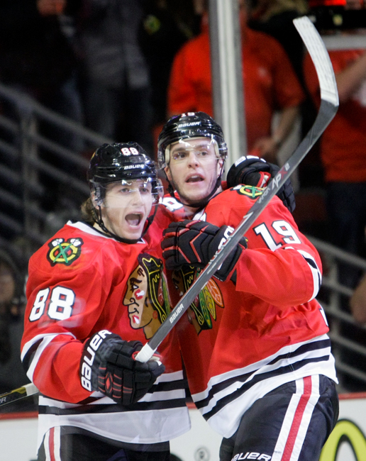 Chicago Blackhawks captain Jonathan Toews (19) celebrates with forward Patrick Kane (88) after scoring the opening goal in the first period of Game 3 against the St. Louis Blues in the first-round NHL hockey playoff series at the United Center in Chicago on Monday, April 21, 2014. | Michael Jarecki/For Sun-Times Media