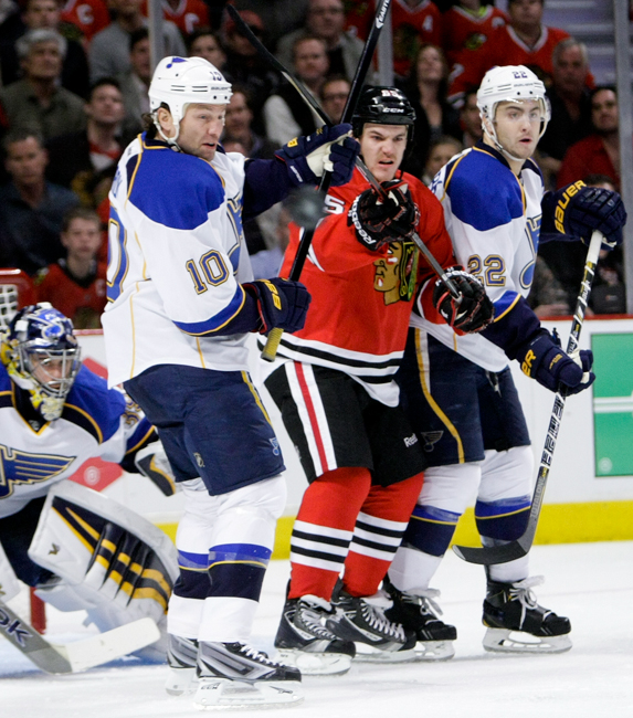 Blackhawks forward Andrew Shaw (65) battles in front of the net with St. Louis Blues forward Brenden Morrrow (10) and defenseman Kevin Shattenkirk (22) in the first period of Game 3 of the first-round NHL hockey playoff series at the United Center in Chicago on Monday, April 21, 2014. | Michael Jarecki/For Sun-Times Media