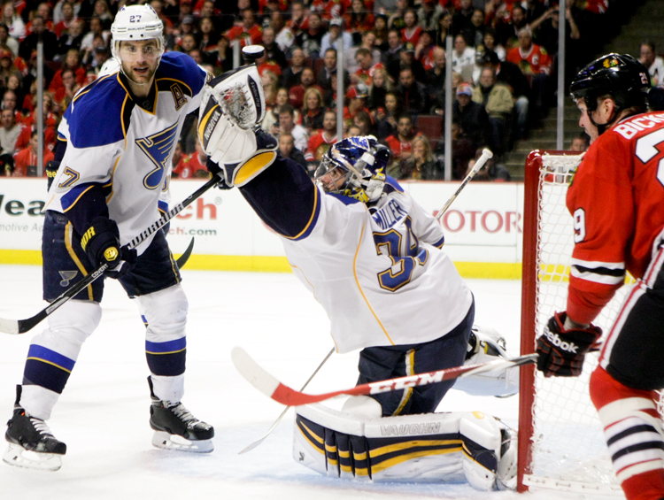 St. Louis Blues goaltender Ryan Miller (39) tries to glove a loose puck in the third period during Game 4 against the Chicago Blackhawks of the first-round NHL hockey playoff series at the United Center in Chicago on Wednesday, April 23, 2014.  The Blackhawks defeated the Blues 4-3 in overtime.  | Michael Jarecki/For Sun-Times Media