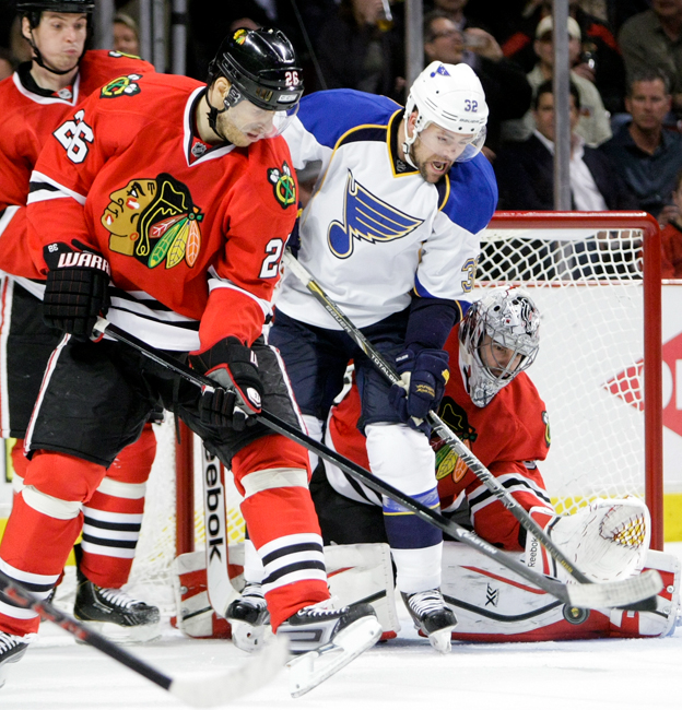 Chicago Blackhawks goaltender Corey Crawford (50) makes a save in the second period of Game 3 of the first-round NHL hockey playoff series against the St. Louis Blues at the United Center in Chicago on Monday, April 21, 2014.  Crawford shut the Blues out 2-0.  | Michael Jarecki/For Sun-Times Media