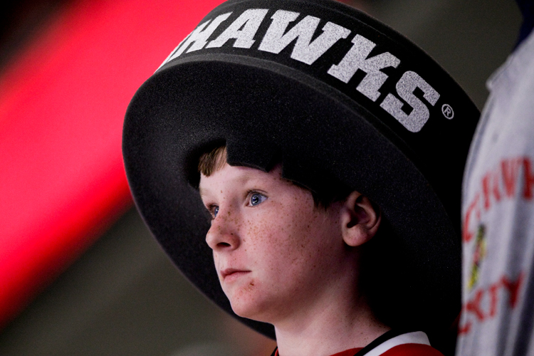 A young Blackhawk fan watches the third period of the NHL Playoff series Game 6 between the St. Louis Blues the Chicago Blackhawks at the United Center in Chicago on Sunday, April 27, 2014.  The Blackhawks defeated the St. Louis Blues 5-1 and will advance to the semi-finals. | Michael Jarecki/For Sun-Times Media