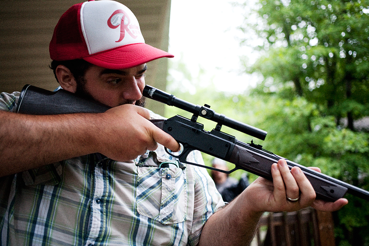 photoblog_chicago_freelance_photographer_michaeljarecki_photojournalist_portrait_gerry_gun_aiming_scope_trucker_hat