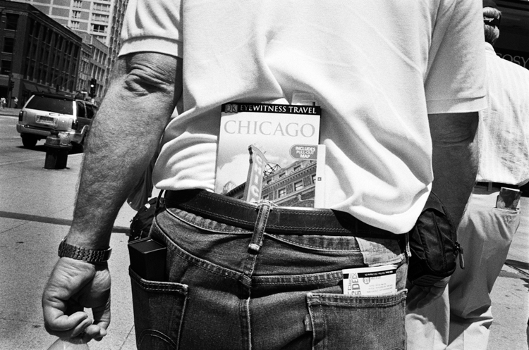 photoblog_chicago_freelance_photojournalist_michaeljarecki_photographer_portrait_tourist_book_jeans_funny_strange