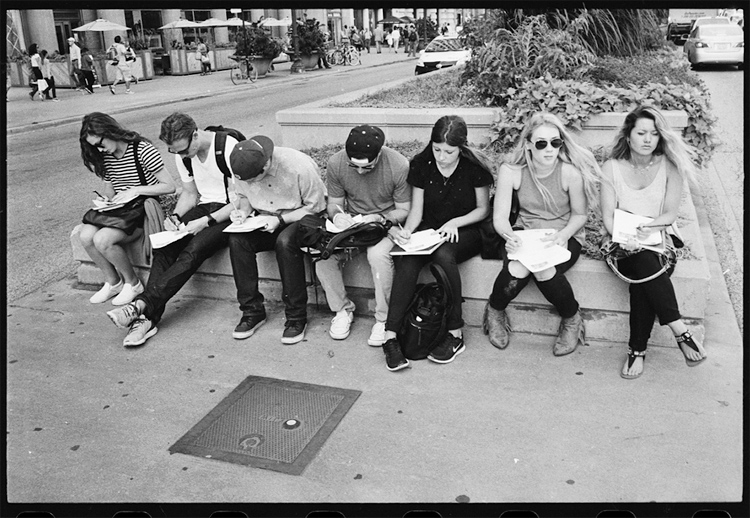 photoblog-freelance-photographer-michaeljarecki-commercial-street-Black&white-candid-students-kids-homework-downtown-people