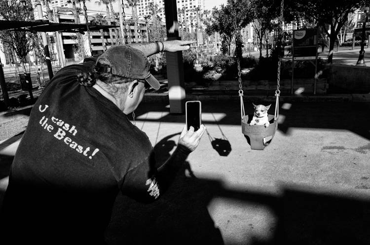 photoblog-freelance-photographer-michaeljarecki-commercial-street_photography-life-candid-black&white-SanDiego-California-people-candid-dog-pet-funny-swing-iphone