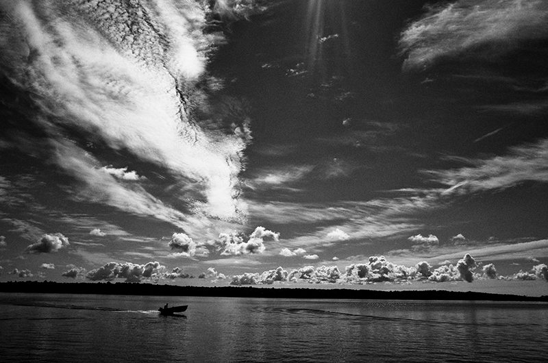 photoblog-freelance-photographer-michaeljarecki-commercial-street-Black&white-candid-cool-awesome-northwoods-wisconsin-longLake-boating-summer-landscape-epic-clouds-sky-fisherman