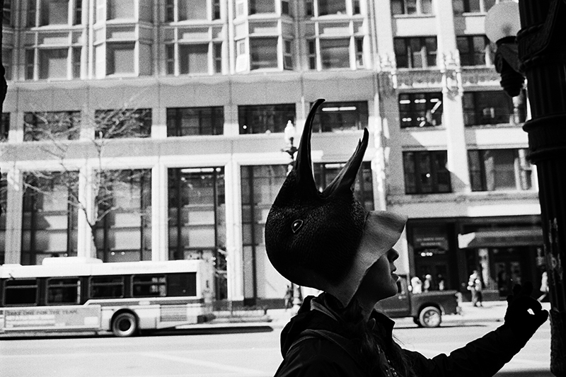 photoblog-freelance-photographer-michaeljarecki-commercial-blackwhite-chicago_street_photography-state_street-mask-costume-bird